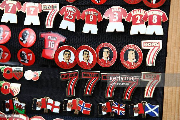 Pin badges for sale prior to the Premier League match between Manchester United and Leicester City at Old Trafford on September 24 2016 in Manchester...