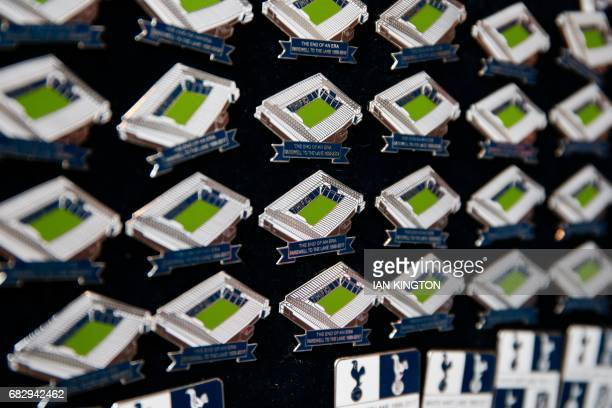 Pin badges in the shape of the stadium are sold outside White Hart Lane in London on May 14 2017 ahead of the English Premier League football match...