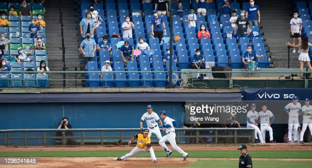 Pin Chieh Chen of Fubon Guardians out at the first base at the bottom of the 3rd inning during the CPBL game between Fubon Guardians and CTBC...