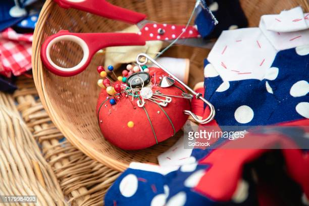 pin cushion and sewing materials - craft stock pictures, royalty-free photos & images
