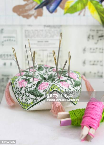Pin cushion with sewing needles