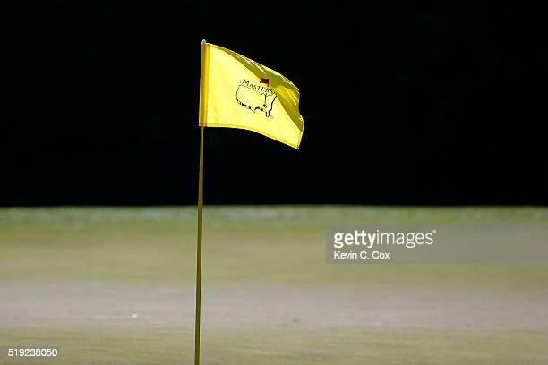 A pin flag blows in the wind during a practice round prior to the start of the 2016 Masters Tournament at Augusta National Golf Club on April 5 2016...