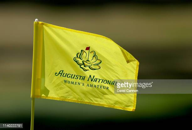 A pin flag flutters in the wind on teh 11th green during the first round of the inaugural Augusta National Women's Amateur at Champions Retreat Golf...
