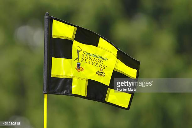 A pin flag waves in the breeze on the 18th hole during the first round of the Constellation Senior Players Championship at Fox Chapel Golf Club on...