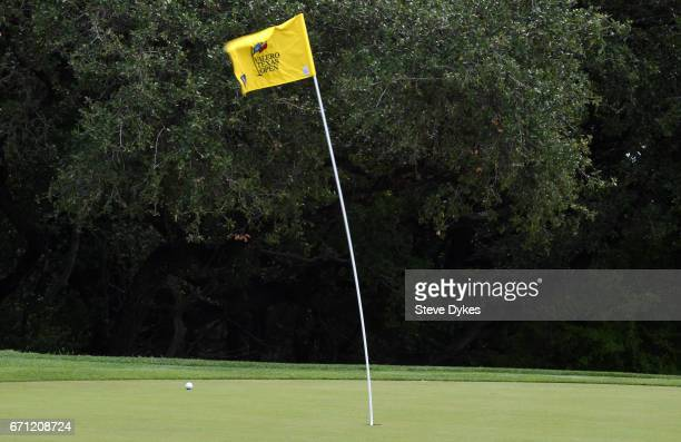 A pin flag waves in the wind on the eighth hole during the second round of the Valero Texas Open at TPC San Antonio ATT Oaks Course on April 21 2017...