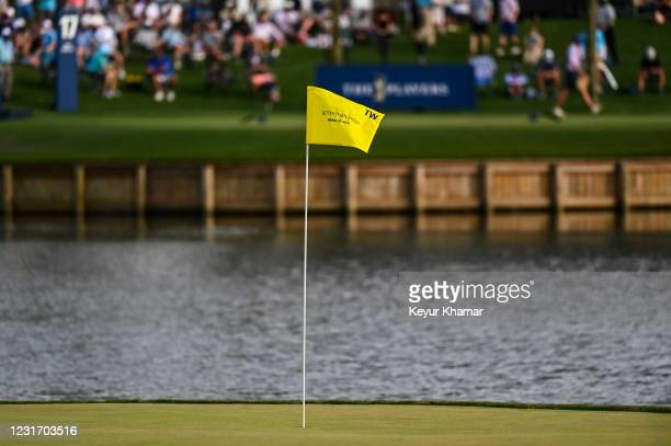 Pin flag with the text Better Than Most to commemorate a putt by Tiger Woods sits on the 17th hole green during the third round of THE PLAYERS...