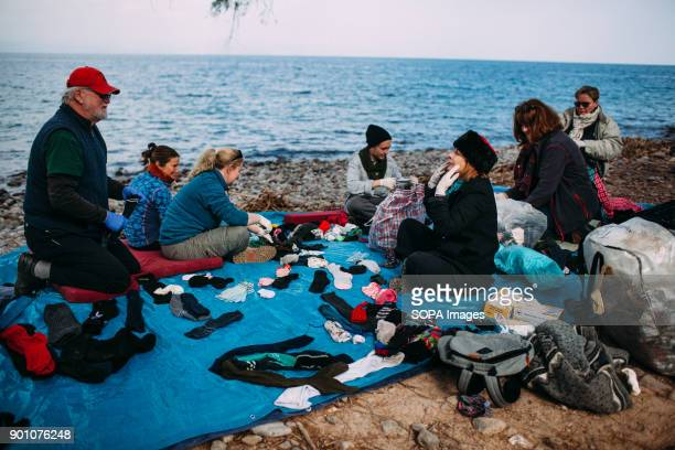 Pin socks parties take place right on the beach where refugees arrive every day Dirty Girls of Lesbos is a volunteer group born in September 2015 by...