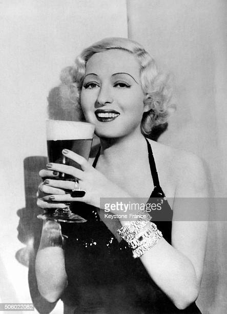 Pin Up a glass of beer in her hands posing in the United States circa 1930