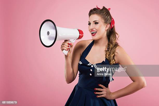 Pin up girl shouting via megaphone. Debica, Poland