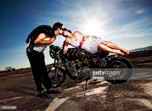 pin up motorcycle series - leg kissing stock photos and pictures