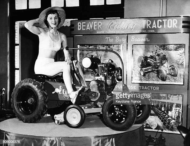 Pin Up posing on a Beaver Tractor at the Flower Show in Stratford Connecticut circa 1940
