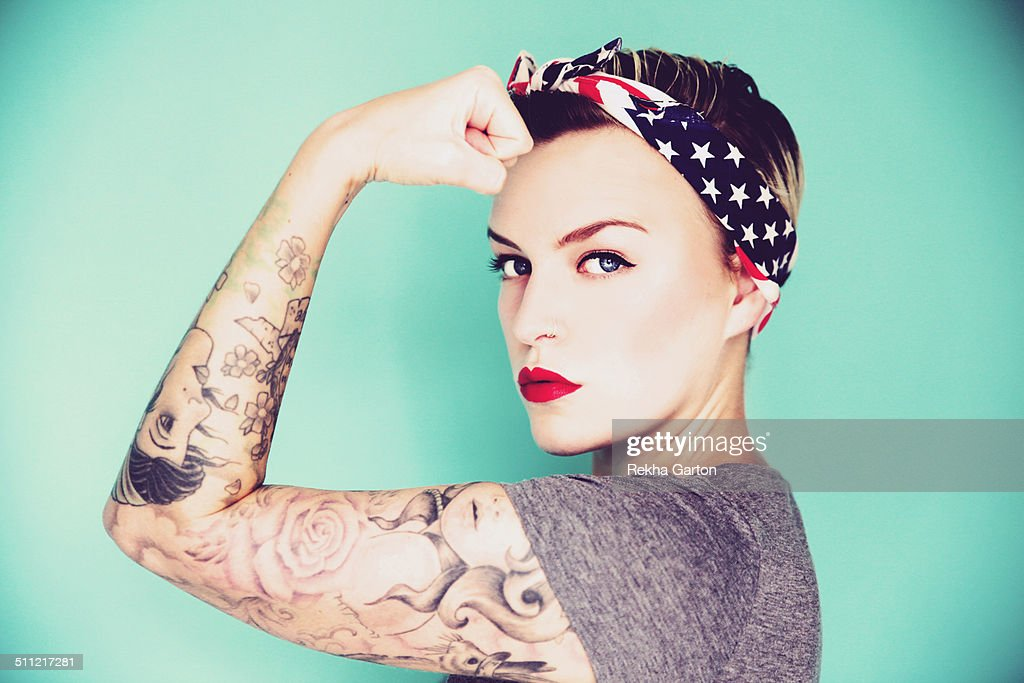 Pin up woman striking a strong woman pose : Stock Photo