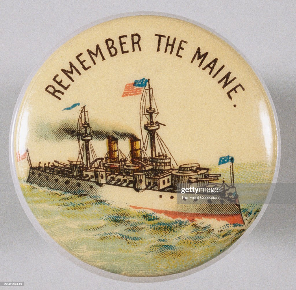 A pin with the patriotic Spanish-American War era slogan 'Remember The Maine'.