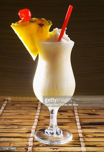 A pina colada garnished with fruit.