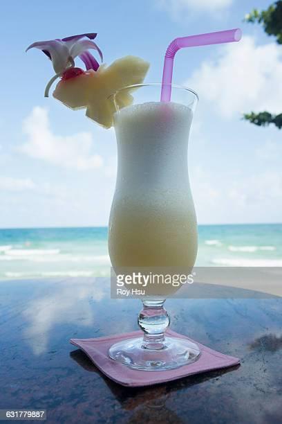 Pina Colada on table near beach