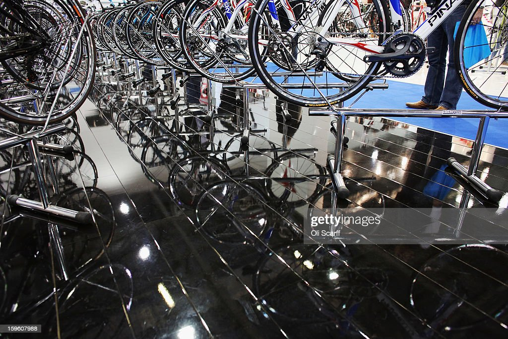 Pinarello bikes are displayed on their stand at the London Bike Show which is being held in the ExCeL Centre on January 17, 2013 in London, England. The ExCeL centre is hosting The Outdoors Show, the London Bike Show and the Active Travel Show which run until January 20, 2013 and features manufacturer trade stalls, speeches, demonstrations and areas where visitors can climb or ride bikes.