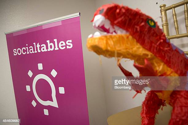 A pinata sits on an awards chair next to Social Tables Inc signage at the company's headquarters in Washington DC US on Thursday Aug 14 2014 Success...