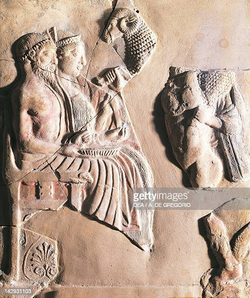 Pinax depicting Persephone and Pluto receiving other gods bearing gifts terracotta unearthed in Locri Calabria Italy Ancient Greek civilization Magna...