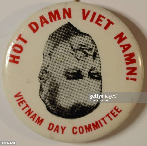 Pinback button from the Vietnam Day Committee with upside down image of United States President Lyndon Johnson with text reading 'Hot Damn Viet Namn'...