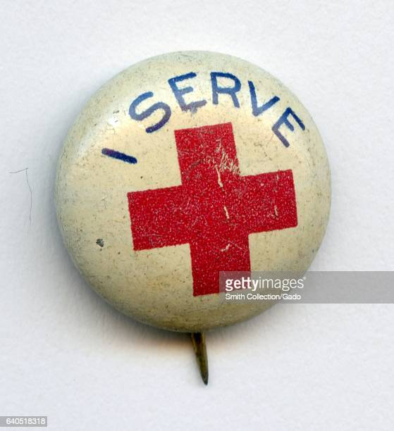 Pinback button in red white and blue promoting the American Red Cross with the lettering 'I Serve' 1940