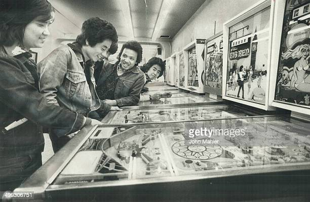 Pinball machines such as these in a Yonge St arcade are considered by some Metro politicians to be a corrupting influence on young people But some...