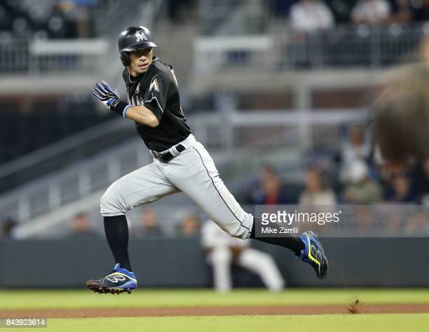 Pinch hitter Ichiro Suzuki of the Miami Marlins runs to second base in the eighth inning during the game against the Atlanta Braves at SunTrust Park...