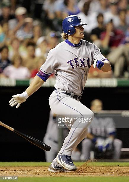 Pinch hitter Jason Botts of the Texas Rangers turns on an RBI single to put the Rangers ahead of the Colorado Rockies in the sixth inning on June 23...
