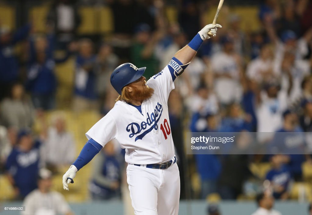 Pinch hitter Justin Turner #10 of the Los Angeles Dodgers watches his solo home run in the ninth inning against the Philadelphia Phillies at Dodger Stadium on April 29, 2017 in Los Angeles, California. It was the third of three home runs in a row for the Dodgers to lead off the inning and tie the game at 5-5. The Dodgers went on to win 6-5.