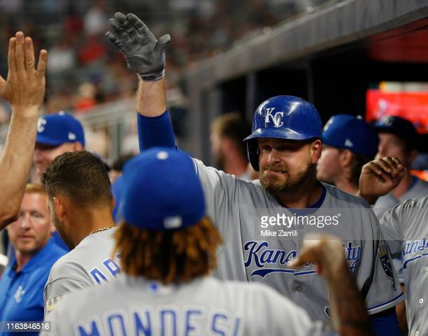 Pinch hitter Lucas Duda of the Kansas City Royals is congratulated in the dugout after hitting a solo, go-ahead home run in the eighth inning during...