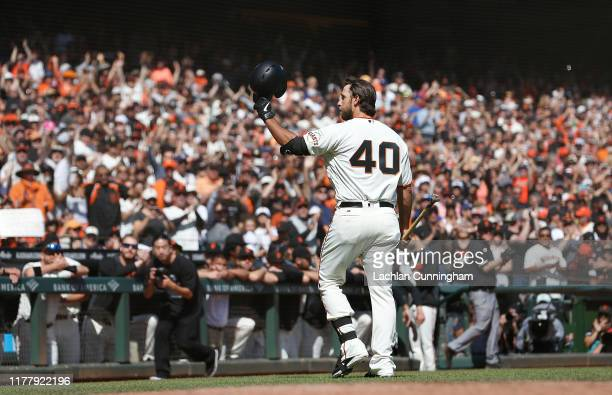 Pinch hitter Madison Bumgarner of the San Francisco Giants acknowledges the fans after batting in the bottom of the fifth inning against the Los...