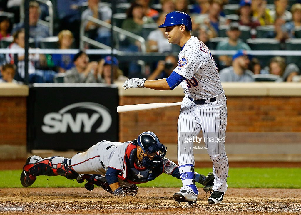 Pinch hitter Michael Conforto #30 of the New York Mets strikes out to end the seventh inning with the bases loaded as Juan Centeno #37 of the Minnesota Twins applies a tag at Citi Field on September 17, 2016 in the Flushing neighborhood of the Queens borough of New York City.