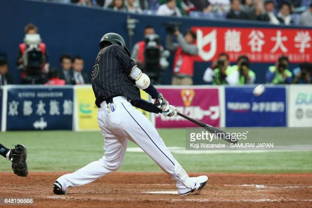 Pinch hitter Shogo Akiyama of Japan hits a tworun triple in the top of the ninth inning during the World Baseball Classic WarmUp Game between Japan...