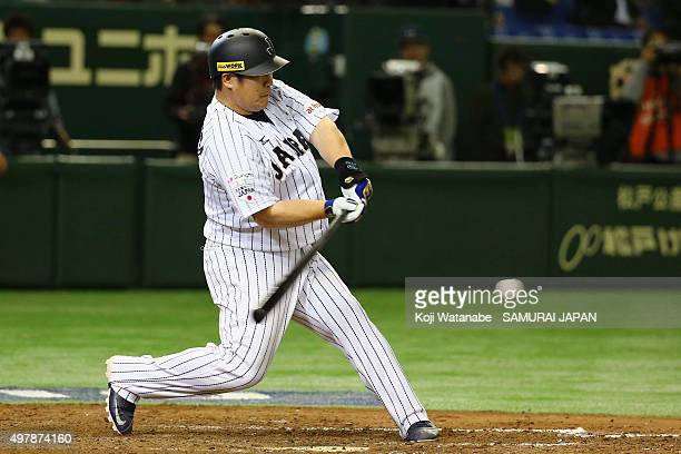 Pinch hitter Takeya Nakamura of Japan hits a grounder in the bottom of ninth inning during the WBSC Premier 12 semi final match between South Korea...