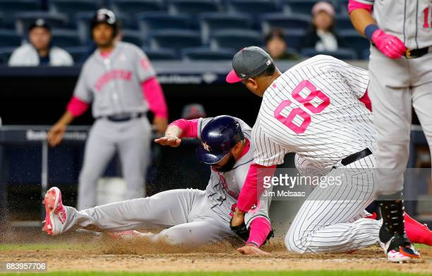 Pinch runner Marwin Gonzalez of the Houston Astros scores in the ninth inning on a passed ball against Dellin Betances of the New York Yankees at...