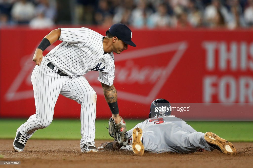 Pinch runner Michael Taylor #3 of the Washington Nationals is caught stealing second base in the eighth inning by Gleyber Torres #25 of the New York Yankees at Yankee Stadium on June 13, 2018 in the Bronx borough of New York City.
