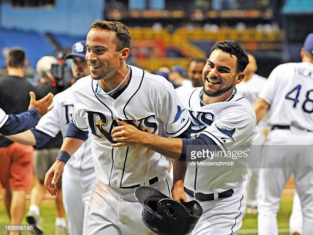 Pinch runner Sam Fuld of the Tampa Bay Rays celebrates after scoring the winning run in the 12th inning against the Texas Rangers September 18 2013...