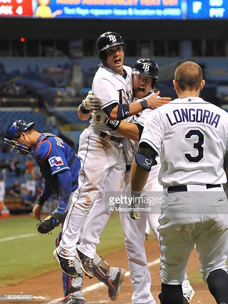 Pinch runner Sam Fuld of the Tampa Bay Rays celebrates with teammates after scoring the winning run in the 12th inning against the Texas Rangers...