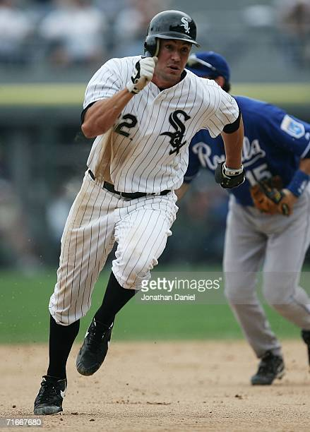 Pinch runner Scott Podsednik of the Chicago White Sox rounds second base on his way to scoring the winning run on a double by teammate Paul Konerko...
