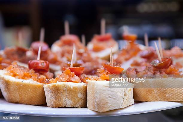 Pincho or Pintxo of cod, paprika & Cherry tomatoes
