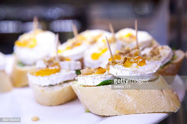 Pincho or pintxo of goat cheese and peach jam