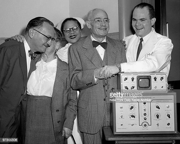 Pincus Shapiro shankes hands with Dr Seymour Furman and his wife Estelle kisses one of the doctors who attended him before leaving Montefiore...