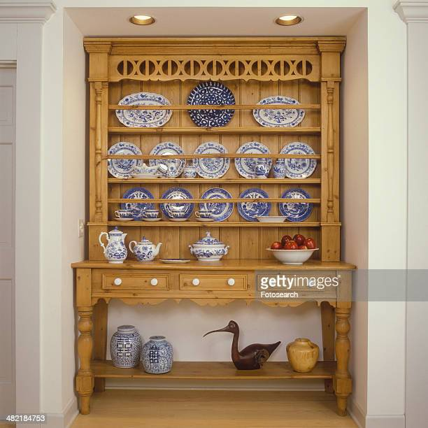 Pine cupboard with blue and white china