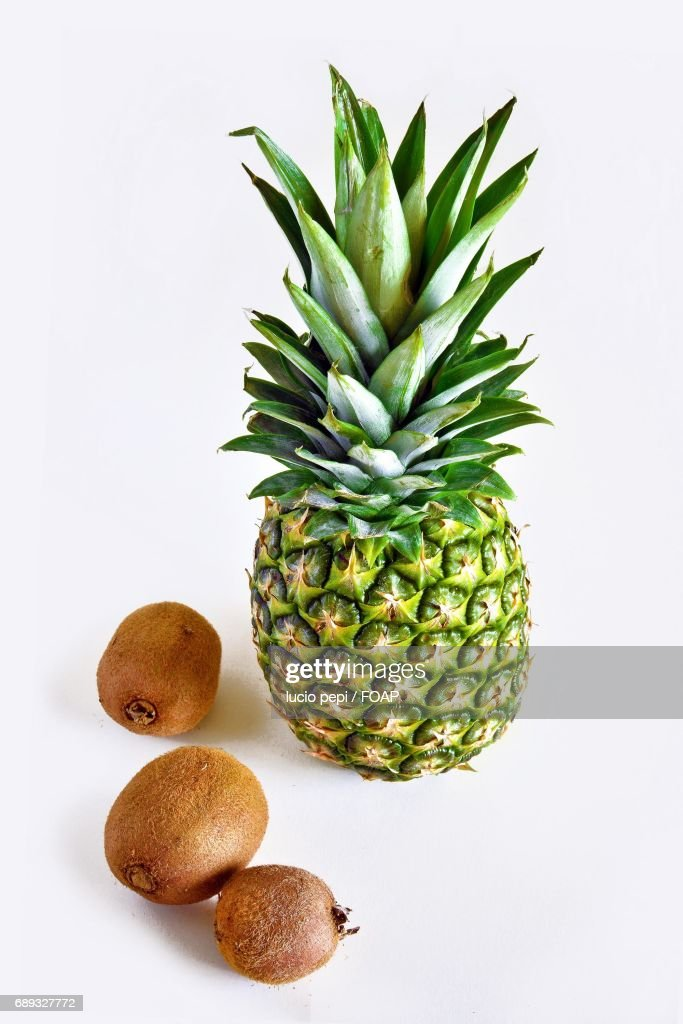 Pineapple and kiwi fruits with white background : Stock Photo