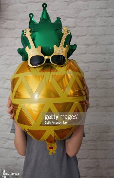 pineapple balloon wearing sunglasses - novelty item stock pictures, royalty-free photos & images