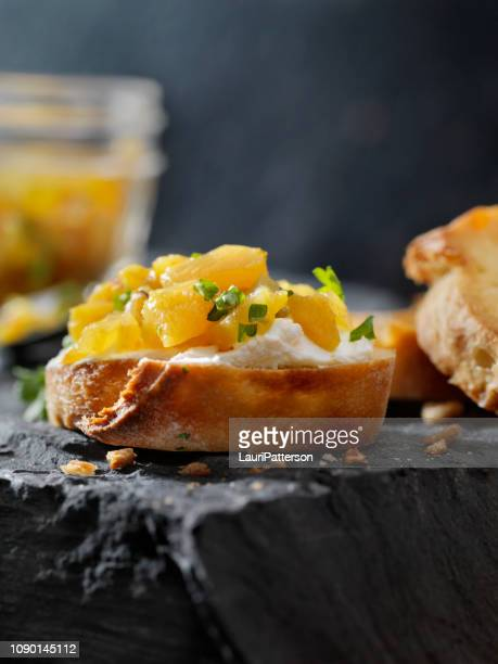 pineapple chutney crostini with cream cheese - chutney stock pictures, royalty-free photos & images