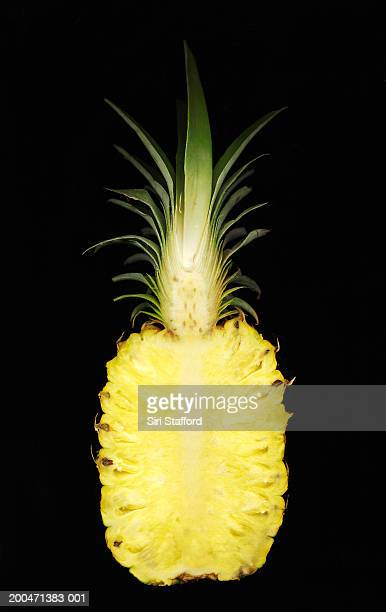 Pineapple (Ananas comosus) cut in half