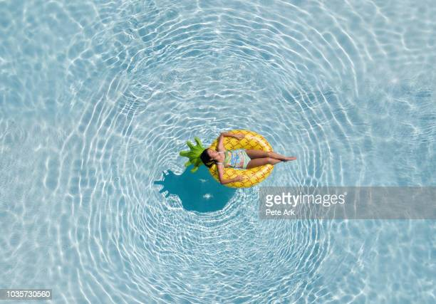 pineapple float - pool stock pictures, royalty-free photos & images