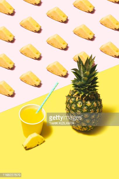 pineapple juice flat lay on pink and yellow background - colour block stock pictures, royalty-free photos & images