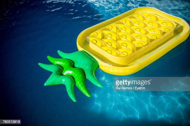 Pineapple Shaped Inflatable Raft Floating On Swimming Pool