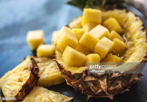 pineapple smoothie with fresh pineapple on wooden table - pineapple stock pictures, royalty-free photos & images